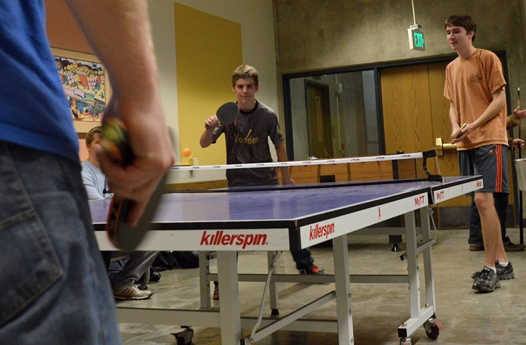 Dylan Spence (center) and Galen Richards (right) prepare to receive the ball after a serve from Ethan Batson (left) during a game of doubles at the Table Tennis Club on Nov. 5.